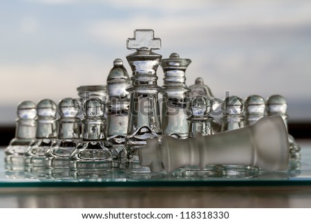 Chess win - Checkmate! King & chess pieces or chess set with fallen king.