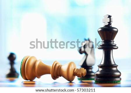 chess winner defeats white king abstract blue background