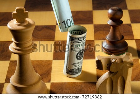 Chess with dollar and euro banknote. Symbol for devaluation of the dollar against the Euro.