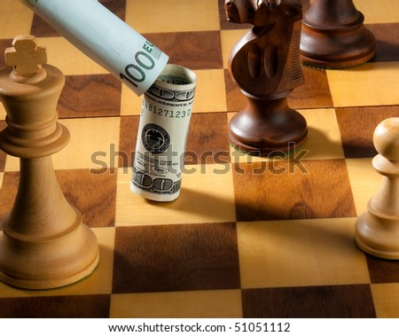 Chess with the dollar and euro bank note. Icon for depreciation of the dollar against euro.