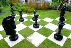 Chessboard and chess in the green park