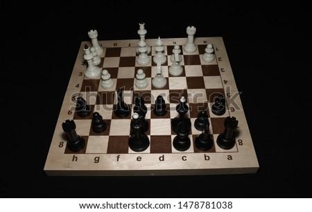Chessboard and white chessmen for hobby theme #1478781038