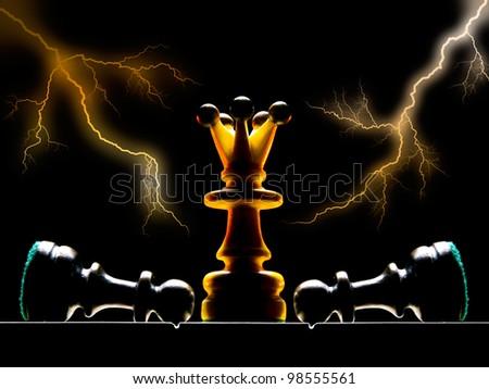 Chessmen on a chess board. A dark background and art illumination.