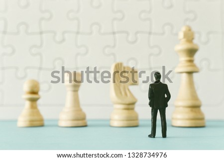 chesss with miniature people over wooden table ,human resources, problem solving and management concept