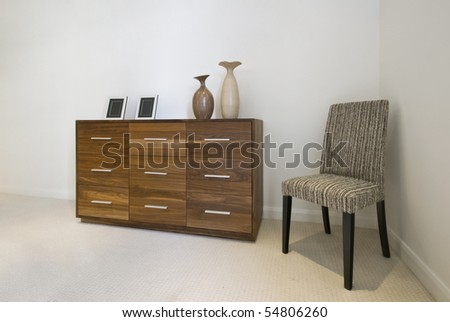 chest of drawers and a designer char with decorative elements