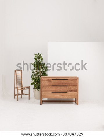 chest of drawers interior decor with wood chair