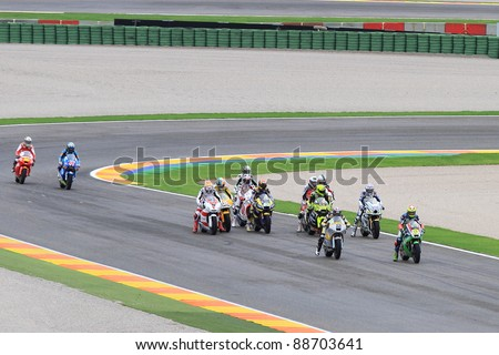 CHESTE - NOVEMBER 6: All categories drivers and Kevin Schwantz tribute to Marco Simoncelli with a lap in his memory at final race of Grand Prix 2011 on November 6, 2011 in Cheste (Valencia), Spain