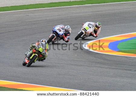CHESTE - NOVEMBER 6: Héctor Faubel of Bankia Aspar Team lead the curve in the final race of MotoGP Grand Prix 2011 on November 6, 2011 in Cheste (Valencia), Spain