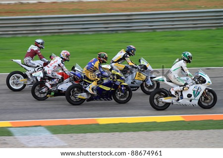 CHESTE, SPAIN  - NOVEMBER 6: All categories drivers and Kevin Schwantz tribute to Marco Simoncelli with a lap in his memory at final race of Grand Prix 2011 on November 6, 2011 in Cheste (Valencia), Spain