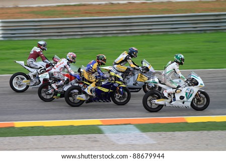 CHESTE, SPAIN - NOVEMBER 6: All categories of drivers and Kevin Schwantz\'s tribute to Marco Simoncelli ride a lap in his memory at final race of Grand Prix 2011 on November 6, 2011 in Cheste (Valencia), Spain