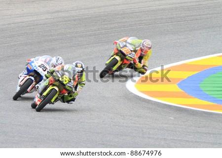 CHESTE, SPAIN - NOVEMBER 6: Héctor Faubel of Bankia Aspar Team lead the curve in the final race of MotoGP Grand Prix 2011 on November 6, 2011 in Cheste (Valencia), Spain