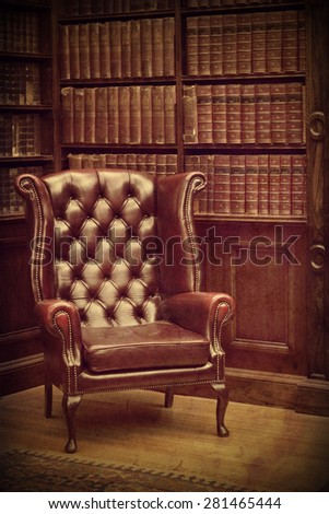 Chesterfield leather armchair in classical library vintage style. Traditional British retro study room #281465444