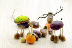 Chestnut acorns figure of a horse and deer. Autumn creativity.