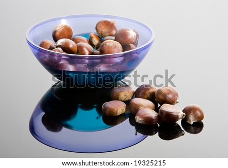 Chestnuts and blue plastic plate
