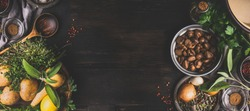 Chestnuts cooking ingredients on dark rustic background, top view, place for text. Seasonal food and eating. Banner