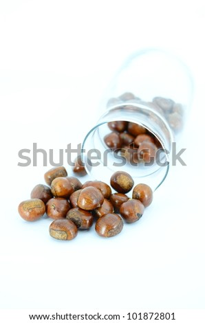 chestnuts-marron in glasses with isolated background