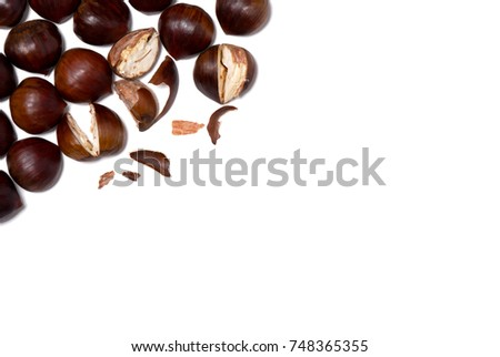 Chestnuts on a blank (white) background, arranged on top left corner, with copy space. #748365355