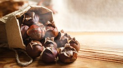 Chestnuts on a wooden background.