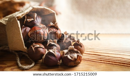 Chestnuts on a wooden background. Foto stock ©