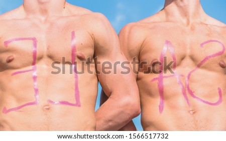 Chests of sexy muscular athletes, nude torsosand sky on background. Inscription sale on sexy muscular chests. Muscular torsos of strong sportsmen with word sale written on. Sale concept.