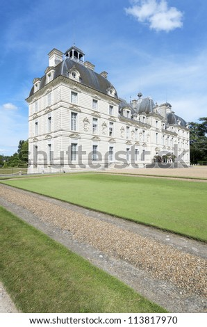 CHEVERNY, FRANCE - AUGUST 16: Castle on August 16, 2012 in Cheverny: Tourists walk in the castle of Cheverny. Built in the 17th century, was inspired by the work of the best artists of the time.