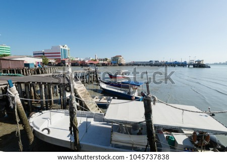 Chew Jetty in Penang, Malaysia. Fishing boats are moored at Chew Jetty which is a World Heritage Site of UNESCO. #1045737838