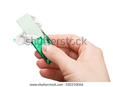 chewing gum in hand - stock photo