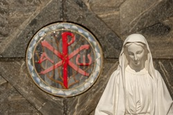 Chi Rho or Labarum and a Statue of Mother Mary, Maria at Basilica of the Annunciation in Nazareth