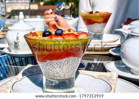Chia pouding with fruits on a glass on a restaurant table Photo stock ©