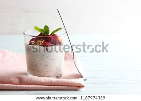 chia pudding with raspberries and granola on a light background. Proper nutrition, super food, healthy breakfast.  #1187974339