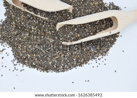 Chia seeds in wooden spoon isolated on white background. healthy eating. healthy lifestyle concept. Heap of chia seeds. copy space. go green
