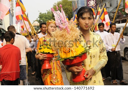 CHIANG MAI THAI-APRIL 13:Chiangmai Songkran festival.Unidentified women walking tradition in parade the Buddha marched on an annual basis. With respect to faith.on April 13,2013 in Chiangmai,Thailand.
