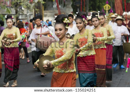 CHIANG MAI THAILAND - APRIL 13 : Songkran festival, Traditional music instrument  in parade  around the city . APRIL 13,2013 in ratchadamnoen road, Chiangmai, Thailand. - stock photo