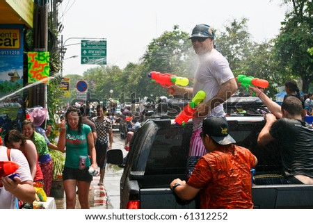 CHIANG MAI, THAILAND - APRIL 13: Tourist shoots from his water gun on April 13, 2010 in Chiang Mai, Thailand. Celebration of Thai New Year (Songkran water festival)  in 2010.