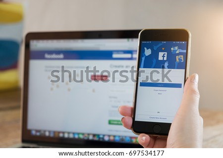 CHIANG MAI, THAILAND - AUG 17, 2017: A man holds Apple iPhone 6S with facebook application on the screen.facebook is a photo-sharing app for smartphones. facebook is a social network.
