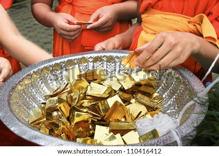 CHIANG MAI  THAILAND - AUGUST 12 : Buddhist metal cast ceremony for buddha statue , Novice collect metal for  ancient metal cast ceremony . Aug 12,2012 in Lok Molee Temple, Chiangmai, Thailand.