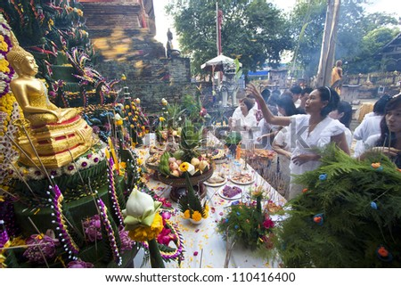CHIANG MAI  THAILAND - AUGUST 12 :Buddhist metal cast ceremony for buddha statue , Throw flower petal  on altar in metal cast ceremony . Aug 12,2012 in Lok Molee Temple, Chiangmai, Thailand.