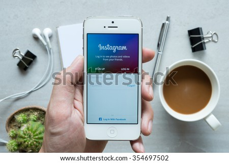 CHIANG MAI, THAILAND - DEC 20,2015: A man holds Apple iPhone with Instagram application on the screen. Instagram is a photo-sharing app for smartphones.