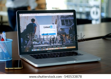 CHIANG MAI ,THAILAND DEC 21 2016 :  Apple Macbook pro with page social network service LinkedIn on the screen.