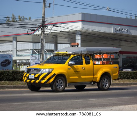 CHIANG MAI, THAILAND -DECEMBER 15 2017: Pickup truck of Department of Highways. Photo at road no.1001 about 8 km from downtown Chiangmai, thailand.