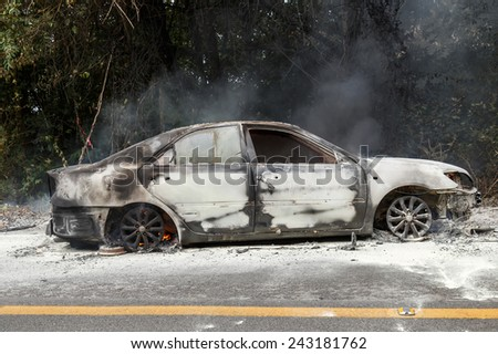 CHIANG MAI, THAILAND - JANUARY 1 : Car fire due to a gas explosion. While driving up to the hill. This makes all the damaged on car but driver is safe on January 1, 2015 in Chiang Mai, Thailand.