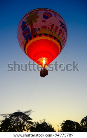 CHIANG MAI, THAILAND - JANUARY 21: Hot air balloons get ready to take flight at the Chiangmai International Balloon Fiesta 2012 in Chiangmai, Thailand on January 21, 2012.