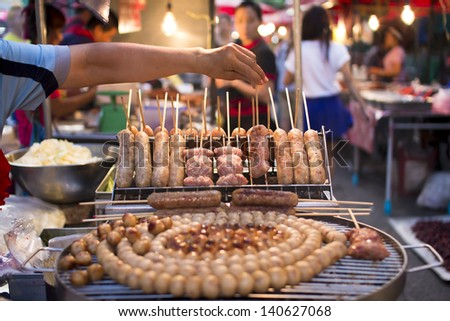 CHIANG MAI, THAILAND - JUN 1: Unidentified shoppers at grilled sour pork in Waroros market on Jun 1, 2013 in Chiang Mai, Thailand. The famous market has been in operation since 1910.