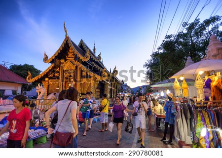 CHIANG MAI THAILAND - JUNE 7 : Sunday market walking street, The city center Thai temple marketing and trading of local tourists come to buy as souvenirs. on June 7, 2015 in Chiang Mai, Thailand.