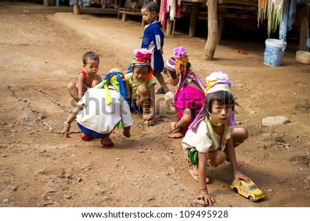 CHIANG MAI, THAILAND - JUNE 13: Unidentified Karen tribe children pose for the camera in Chiang Mai on June 13, 2012. The Karen people wear brass rings from as young as five years old.