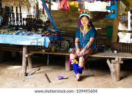 CHIANG MAI, THAILAND - JUNE 13: Unidentified Karen tribe girl poses for the camera in Chiang Mai on June 13, 2012. The Karen people wear brass rings around their neck from as young as five years old.