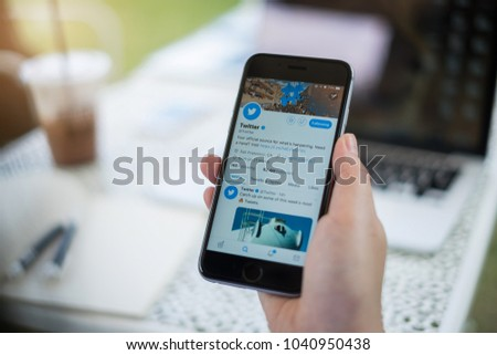 CHIANG MAI, THAILAND - MAR 07, 2018: Person holding a brand new Apple iPhone with Twitter logo on the screen. Twitter is a social media online service for microblogging and networking communication.
