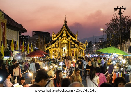 CHIANG MAI THAILAND - MARCH 8 : Sunday market walking street, The city center Thai temple marketing and trading of local tourists come to buy as souvenirs. on March 8 , 2015 in Chiang Mai, Thailand.