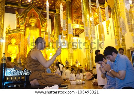 CHIANG MAI THAILAND-MAY 19 : Inthakhin traditional Offerings of flowers.Thai people offering proceed to the monks at Wat Chedi Luang. on May 19,2012 in Chiangmai Thailand.