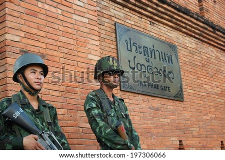 CHIANG MAI,THAILAND-MAY 24 : The soldiers of the junta come into the city to control people that against coup or junta by symbolic speech and show activity, On May24, 2014.